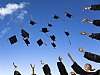 Graduates throwing academic hats into the air