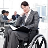 a woman in wheelchair works in an office