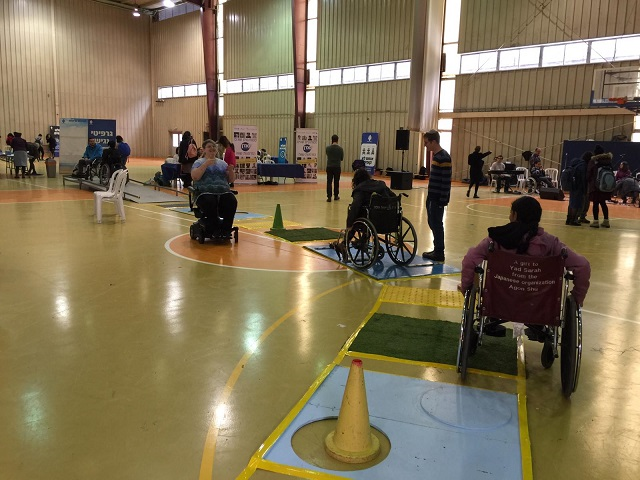 The participants passed through a challenging obstacle course while riding wheelchairs