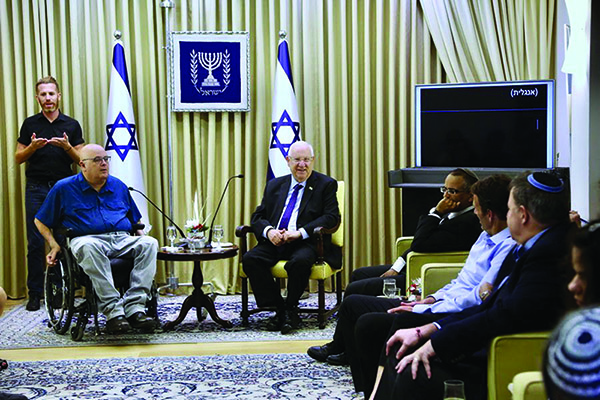 President Rivlin welcomes his guests from NYC